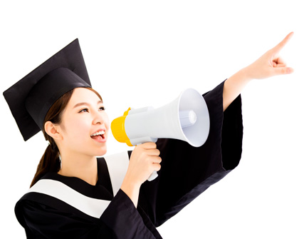 woman wearing graduation cap and gown pointing with megaphone